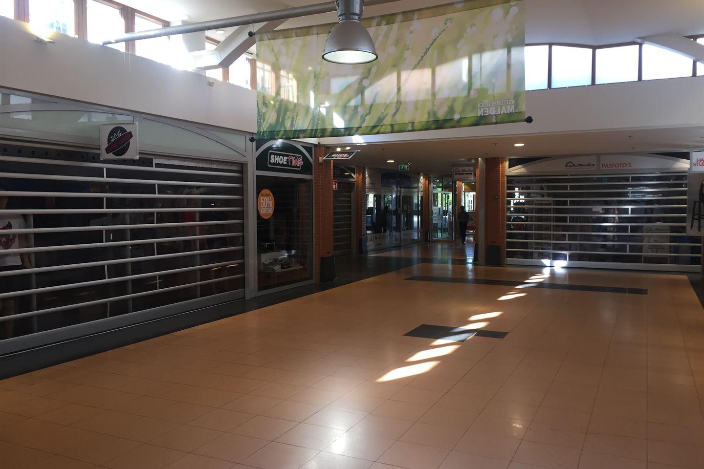 Bekijk foto 4 van Winkelcentrum 40