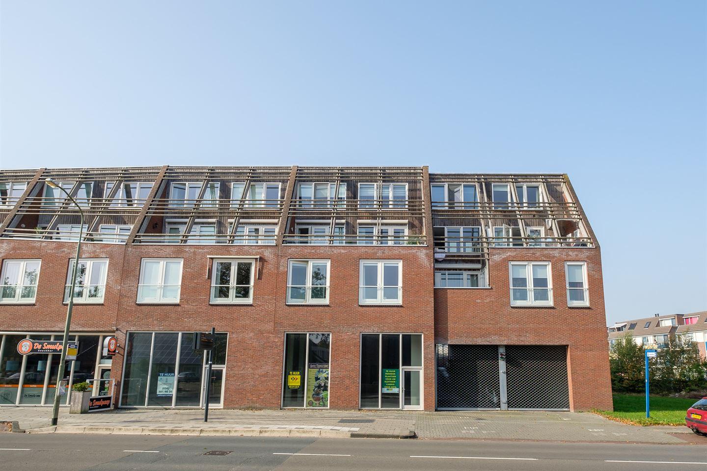 Bekijk foto 1 van Raadhuisstraat- Parkeerplaatsen