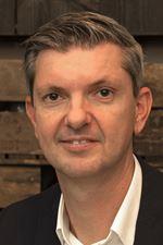 H.J.C. van Hout (Directeur)