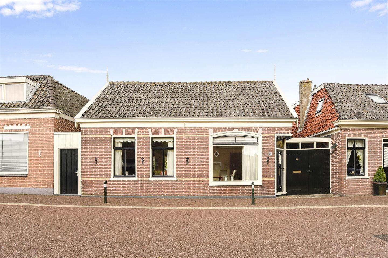 Bekijk foto 1 van Raadhuisstraat 48