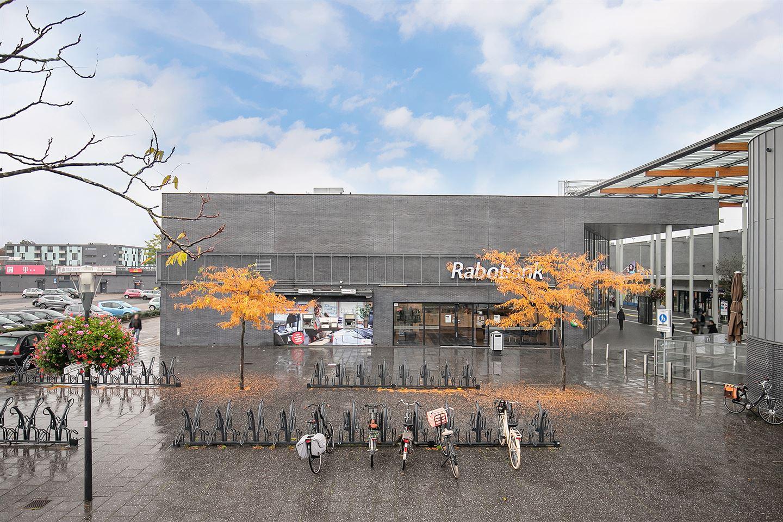 Bekijk foto 2 van Winkelcentrum Woensel 400
