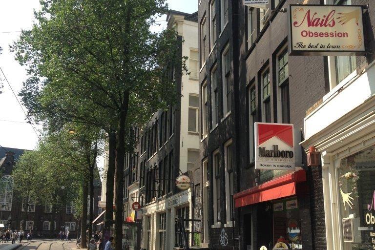 Bekijk foto 2 van Nieuwezijds Voorburgwal 334 II-III
