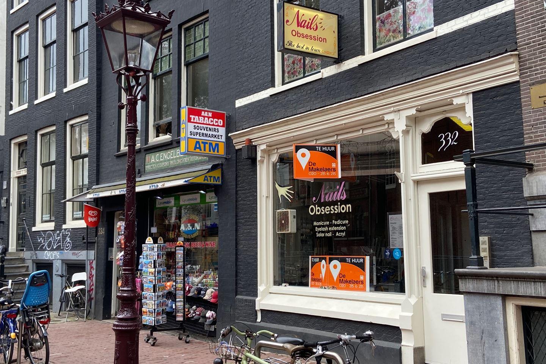 Bekijk foto 1 van Nieuwezijds Voorburgwal 332