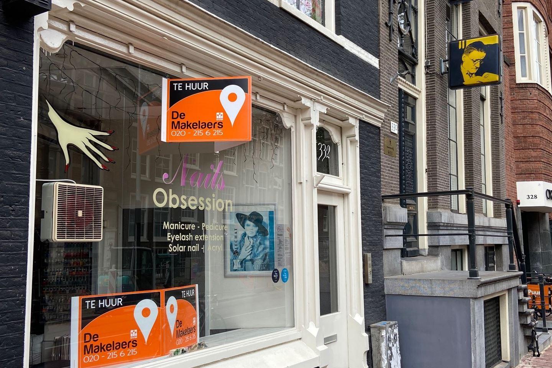 Bekijk foto 2 van Nieuwezijds Voorburgwal 332